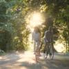 videoblocks-cute-family-couple-riding-bikes-on-sunny-sunday-morning-having-lovely-talk-as-cycling-along-the-lane_soltmnpjx_thumbnail-full01