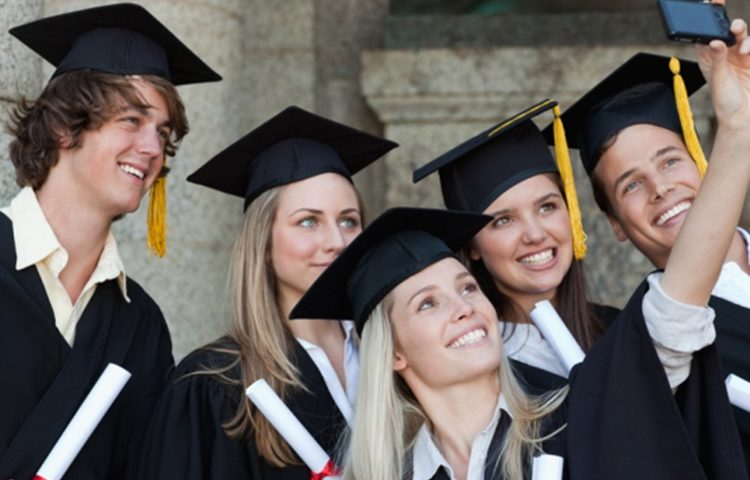 Close-up of five graduates taking a picture of themselves