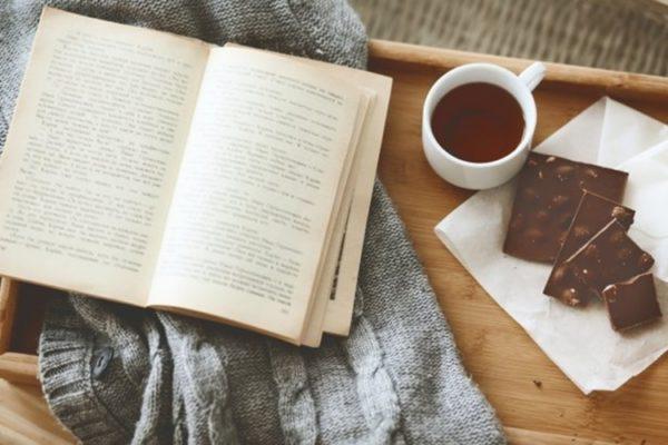 comfort-tray-book-chocolate-cup-tea-sweater