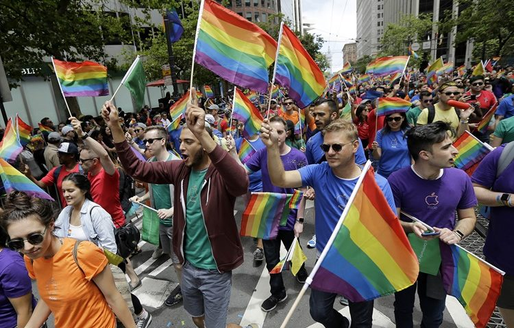 A group of marchers walk at the Pride parade in San Francisco, Sunday, June 25, 2017. (AP Photo/Jeff Chiu)