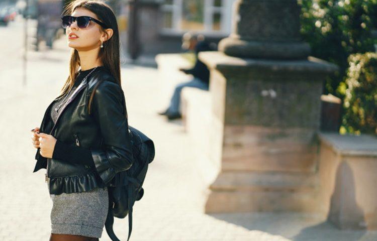 stylish-girl-walking-through-city-warm-sunny-autumn-day_1157-12018
